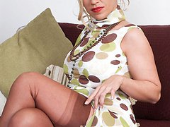 Classy milf Taylor strips to sheer panties and nylons to wank herself off
