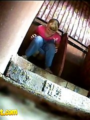 Two babes pissing in a spycammed park toilet