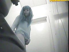 Chicks� gushing slits filmed by spy cam in toilet