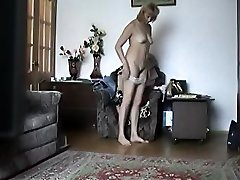 Stripping mature chick gets filmed by a voyeur