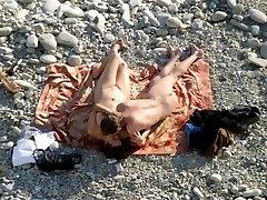 Nude beach couple please use their hands for fun