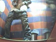 Voyeur films girls pissing in public toilet