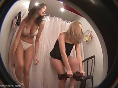 Two unsuspecting gals fit the bikinis in the looker room