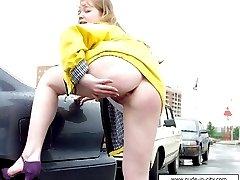 Chubby teen flashing pussy at car parking