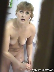 Housewife takes a shower under spy cam control