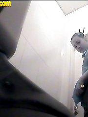 Raunchy hottie urinates onto spy cam in public loo