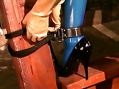 Latex mistress Jean Bardot gets her cute female slave's body and mouth stretched to the limit