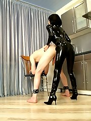 Kinky bitch in black latex catsuit plows masked fatsos ass with strap-on