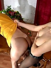 Smashing babe makes a guy suck and impale his asshole on her strap-on dick