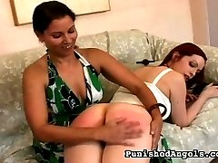 Two young girls get paddled with a paddle and a hairbrush and also whipped on the ass with a cat...