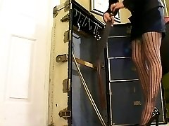 Stunning brunette is stripped and mercilessly spanked on her bare ass