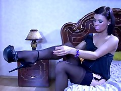 Slim-legged teaser in sexy black stockings and heels flashes her ass cheeks