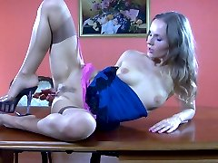 Dressy girl in stockings pleasures herself after a frustrating phone call