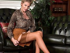 Danielle the I.O.A.M. CEO strips to glamour wear, heels and real nylons.