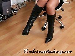 Secretary in stockings masturbates at her desk