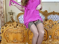 Insane hottie in a pink dress and tan nylons assumes some pretty crazy poses