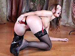 Enticing hottie in black lacy stockings and penetrate-me-heels having solo anal