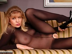 Angel in black bodystockings and ebony six inches heels