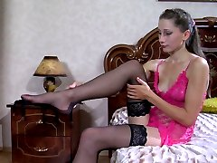 Long-legged hottie changes her lacy nightie for black nylons and high heels