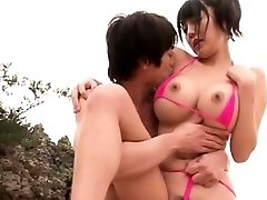 Large tit Japanese pummeled at the beach