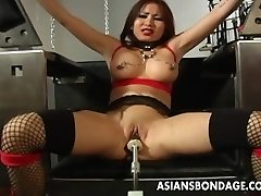 Buxom brown-haired getting her wet pussy machine fucked