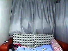 Asiático adolescente desnudándose en la webcam