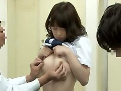 Noisy oriental student getting frigged by her physician on the medical bed