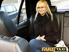 FakeTaxi Blonde with glasses gets talked into sex gauze