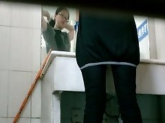 Toilet voyeur flick of Chinese girl pissing in restaurant