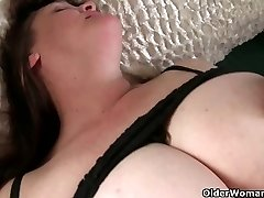 Busty granny has to take care of her pulsating hard clit
