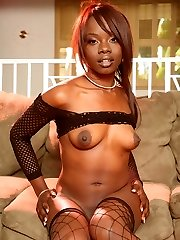 Pint sized black hottie Ashley Brooks juggles on a big salami and drains it with her mouth