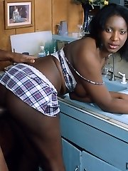 Ebony hottie gets humped firm in the kitchen