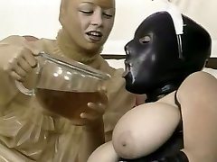 Two kinky gals in latex outfit lick each other snatches in 69 fashion
