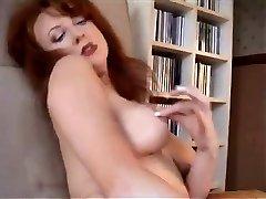Redheaded MILF In Retro Undergarments