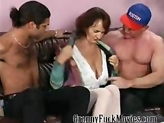 Granny with rock-hard tits fucking two