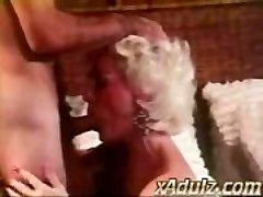 Retro Grey Haired Granny Gives Sensual Inhale and Boob Job