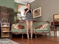 Hot brunette Chelsea French undresses off and drains in stunning leopard print heels and in vintage nylons with a sheer garter belt