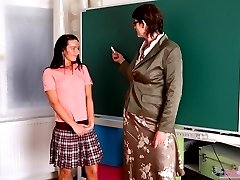 Olya and her sexy friend are done with the schoolwork, and their teacher tells them about how...