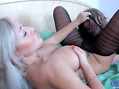 Blonde lesbian in black patterned tights strap-on fucked by her girlfriend