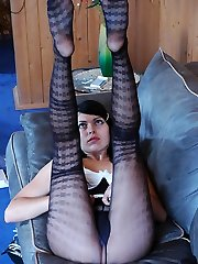 Spunky brunette admires the look of her legs and booty in patterned pantyhose