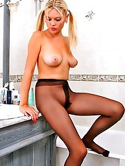 Pony-tailed chick posing in her dark-hued sheer-to-midbody pantyhose in bathroom