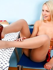 Awesome woman in barely visible pantyhose touches some objects with her feet