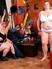 The fat girls in the bar get naked for the slender guys and then one lies down for great sex