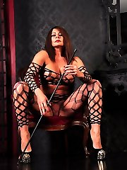 Domme Carly is not pleased with her submissive and determines to punish his knob and balls with her foot.