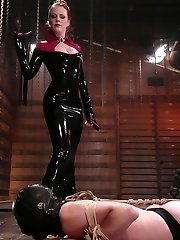 Latex Goddess Lydia McLane lords her power over slave boy rick as he wriggles in an escape attempt from rope bondage while under the laughing Dominatrixes crop.  A chilling sounds scene follows, and Lydia continues her humiliating brunt by commanding rick to recite 'I like how my little coochie is getting fucked' while reaming out his urinate slit with the thick, steel rods.  In the end, rick is hung and romped in the ass while Lydia strokes her gloved hands over his hard, aching shaft.  Maybe she will even permit him to come?