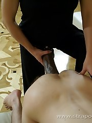 Raunchy dark-haired slut slams a thick strap-on cock up her boy's wooly ass