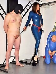 Mistress Carly fucks her gimp and latex sex woman with her yam-sized black strapon, then instructs her doll to take a real hard-on
