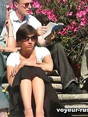 Hot babes sitting on the steps in their skirts are easy preys for our spy cams