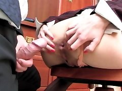 Lewd secretary in strict office suite and nylons opening up her ass cheeks