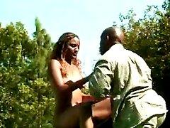 Muscular black guy fucks a very hot ebony babe in his back yard